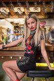 Beautiful stylish girl sitting at bar Royalty Free Stock Image