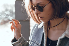 Beautiful and stylish girl in sunglasses on a sunny day. Girl in sunglasses walking on a sunny day Stock Photos