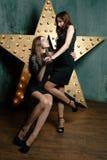 Beautiful stylish girls cuddling Stock Image