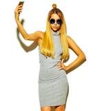 Beautiful stylish hipster model in studio Royalty Free Stock Image