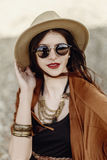 Beautiful stylish hipster woman portrait in sunglasses holding h Royalty Free Stock Photos