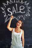 Beautiful stylish lady inviting everyone to visit sale Stock Photography