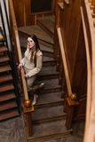 Beautiful stylish lady in suit wallks downstairs Stock Images