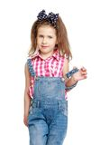 Beautiful, stylish little girl in denim overalls Stock Images