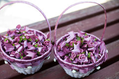 Beautiful, stylish purple flower wedding decoration in baskets c Royalty Free Stock Photography