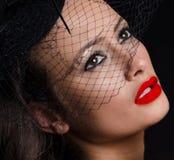 Beautiful, stylish woman wearing a fascinator Royalty Free Stock Image