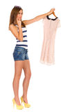 Beautiful, stylish woman choosing dress. Stock Image