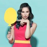 Beautiful stylish woman holding paper balloon. Royalty Free Stock Image