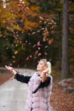 Beautiful stylish woman pose in park in early autumn royalty free stock image