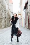 Beautiful, stylish woman posing with a vintage bag Royalty Free Stock Photography