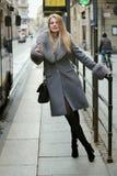 Beautiful stylish woman at the tram stop. Urban lifestyle Royalty Free Stock Photos