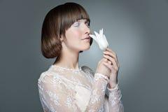 Beautiful stylish woman with tulip Stock Photo