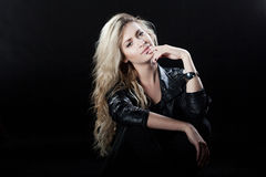 Beautiful and stylish young blonde girl, black Stock Image
