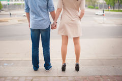 Beautiful stylish young couple standing and holding hands on a background of a big city, love, dating, lifestyle, romance Royalty Free Stock Photos