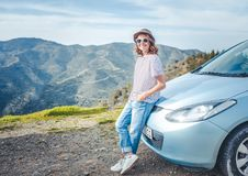 Beautiful stylish young girl travels by car, summer travel, free. Dom, transport for rent, new impressions and adventure, freedom and youth Stock Image