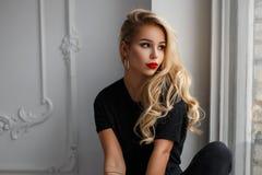 Beautiful stylish young woman in a fashion black T-shirt s stock photography