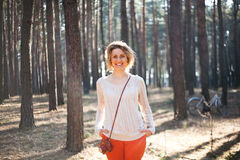 Beautiful stylish Young woman outdoors in the forest Royalty Free Stock Images