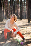 Beautiful stylish Young woman outdoors in the forest Royalty Free Stock Image