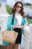 Beautiful stylish young woman on street. Royalty Free Stock Photo
