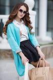 Beautiful stylish young woman on street. Royalty Free Stock Photography