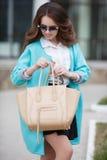 Beautiful stylish young woman on street. Stock Photos