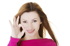 Beautiful success woman giving perfect gesture Stock Photography