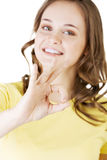 Beautiful success woman giving perfect gesture Royalty Free Stock Photography