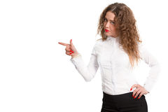 Beautiful successful business woman recommends Your brand is!. Beautiful young smiling woman on a white background pointing her finger to the left Stock Photos
