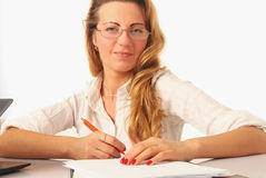 Beautiful successful businesswoman working with documents in the. Beautiful happy successful businesswoman working with documents in the office Stock Photo