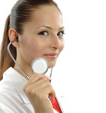 Beautiful successful doctor - Healthcare workers. Beautiful female doctor looking at camera- Healthcare workers - over a white background Stock Photography