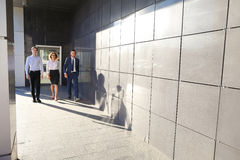 Beautiful successful people, two guys and girl, young businessme Royalty Free Stock Images