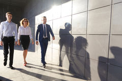 Beautiful successful people, two guys and girl, young businessme Stock Images