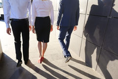 Beautiful successful people, two guys and girl, young businessme Stock Image