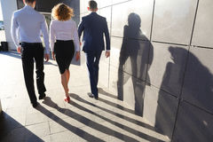 Beautiful successful people, two guys and girl, young businessme Royalty Free Stock Image