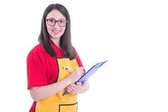 Beautiful successful storekeeper taking notes. On her clipboard isolated on white with copyspace Royalty Free Stock Image