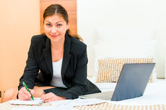 Beautiful successful woman working at the hotel. Beds Royalty Free Stock Photos