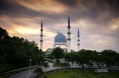 The beautiful Sultan Salahuddin Abdul Aziz Shah Mosque over stunning sunrise background. Soft focus due to long exposure shot Stock Photo