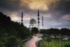 The beautiful Sultan Salahuddin Abdul Aziz Shah Mosque over stunning sunrise background. Soft focus due to long exposure shot Royalty Free Stock Images