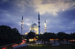The beautiful Sultan Salahuddin Abdul Aziz Shah Mosque over stunning sunrise background. Soft focus due to long exposure shot Royalty Free Stock Image