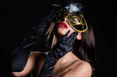 Sultry woman with Venetian masquerade mask Royalty Free Stock Image