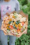 Beautiful summer bouquet. Arrangement with mix flowers. Young girl holding a flower arrangement. The concept of a flower Royalty Free Stock Photos