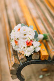 Beautiful summer bridal bouquet lying on a park bench Royalty Free Stock Photography