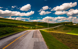 Beautiful summer clouds over a country road in rural York County Royalty Free Stock Photography