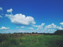 Beautiful summer clouds. Beautiful summer white clouds on a blue sky Royalty Free Stock Photography