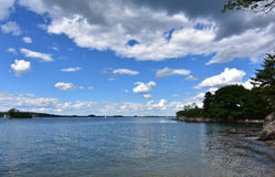 Beautiful Summer Day with Fluffy White Clouds Above Casco Bay Stock Photography