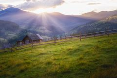 A beautiful summer day in the mountains. Sunset in the mountains, the rays of the sun illuminate the mountains Royalty Free Stock Photography