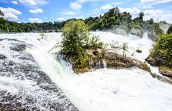 Beautiful summer day view of Rheinfall waterfalls at Rhine River, the biggest waterfalls of Europe, in Schaffhausen, Switzerland Royalty Free Stock Photography