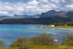 Beautiful summer daylight view of Lofoten Islands. Norway, with mountains, fjord and houses Royalty Free Stock Image