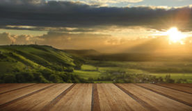 Beautiful Summer evening over countryside landscape with wooden Royalty Free Stock Photos