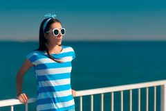 Beautiful summer fashion girl in navy striped shirt and sunglasses royalty free stock photos